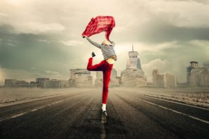 happy woman in red jumping in street in city