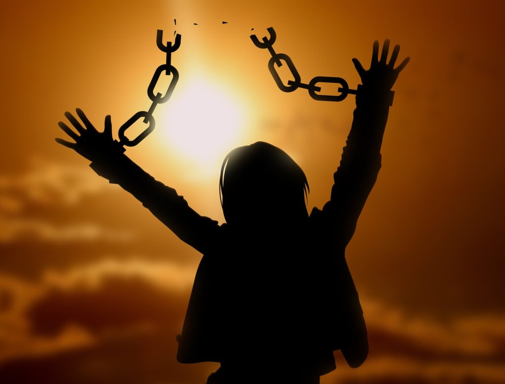 woman sunrise freedom breaking chains