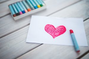 heart drawn on paper with crayons