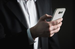 man in suit with a smartphone