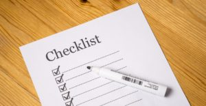 checklist with marker and paper
