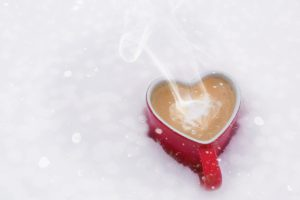 heart shaped coffee mug in the snow